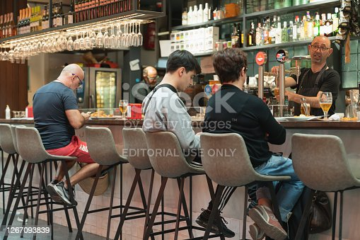 Barcelona spain Nov 04 2019 :People eat at Lonely Planet Barcelona's Sant Antoni Market in Barcelona spain Concepts could include food, health, culture, travel, and others