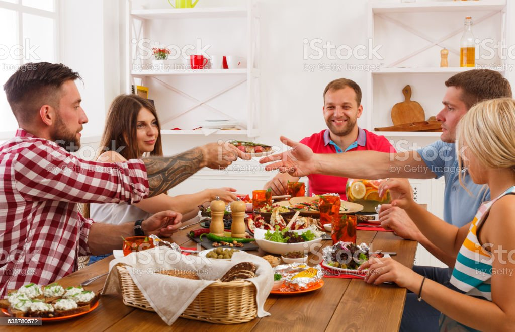 People eat healthy food at festive table dinner party stock photo
