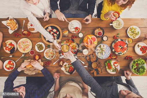 istock People eat healthy meals at served table dinner party 874348828