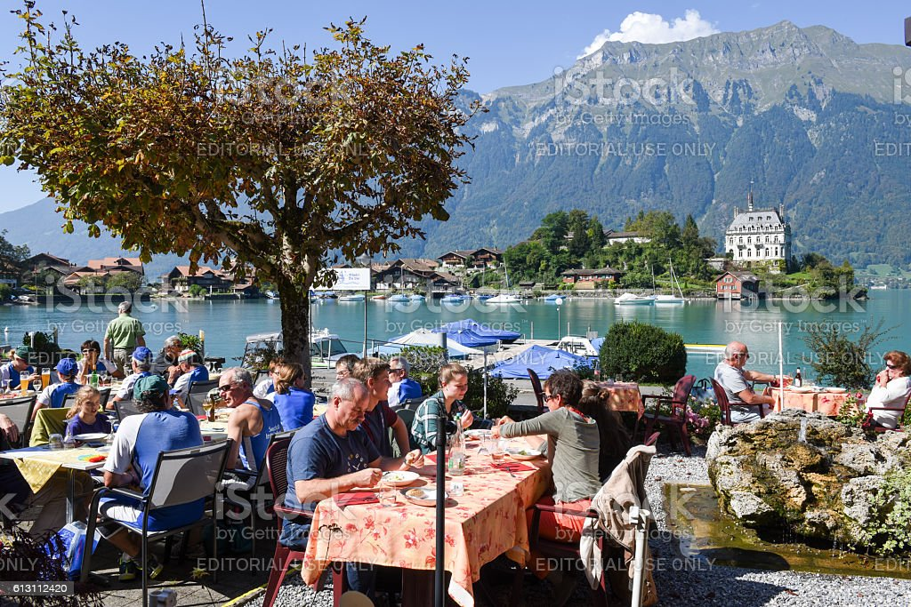 People eating and drinking on a restaurant of Iseltwald stock photo