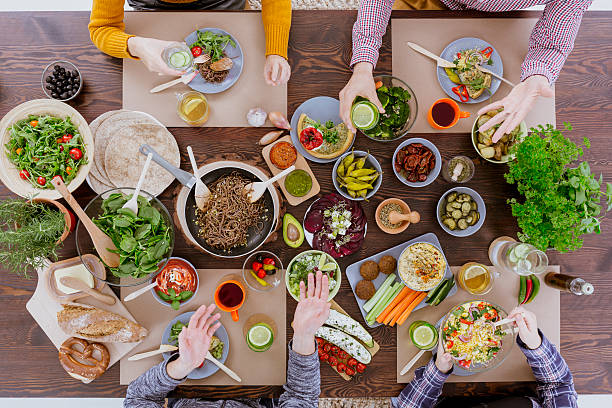 people eating and drinking - vegetarian stock photos and pictures