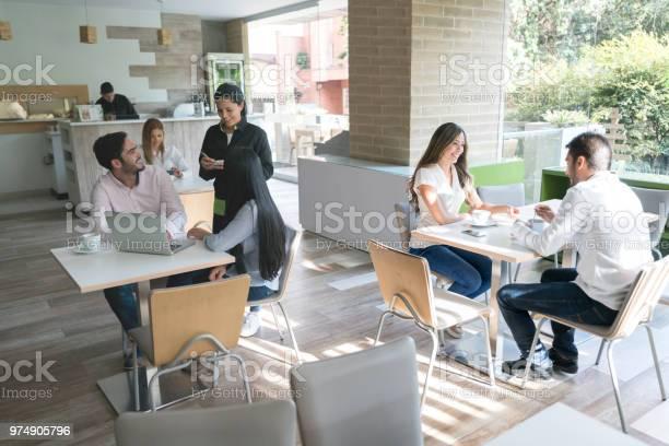 People eating at a restaurant picture id974905796?b=1&k=6&m=974905796&s=612x612&h=gerdzpvh81dnxscfarbdscyftbvd3tuxst3wjc nwzg=