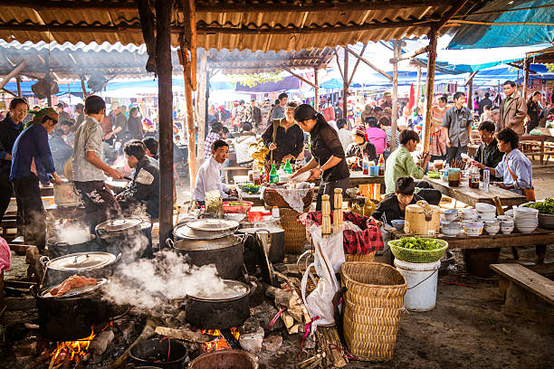 People eating at a street market in Vietnam