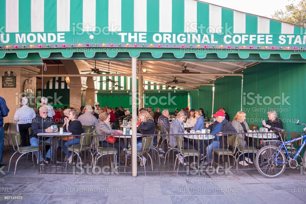 People eating at Cafe du Monde in the French Quarter stock photo