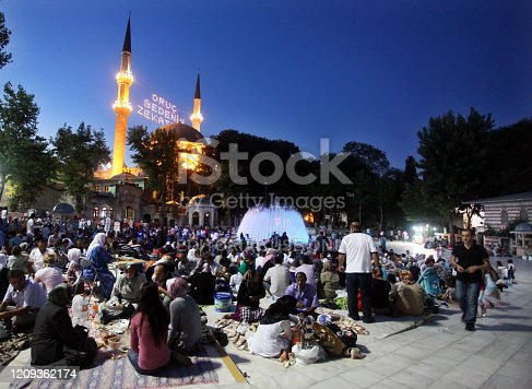 Istanbul, Turkey - August 8: People eating 'Iftar food' near the Eyup Sultan Mosque at Ramadan on August 8, 2011 in Turkey. Built in 1458, first mosque constructed by the Ottoman Turks in the city.