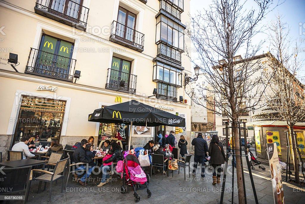 People eating in McCafe, Madrid, Spain stock photo