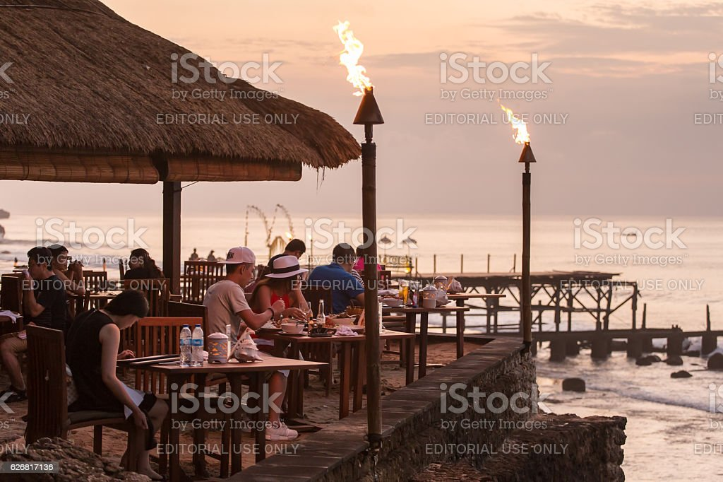 People eating in the famous Rock Bar in Bali, Indonesia stock photo