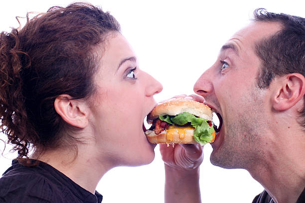 people eating juicy burger - funny fat lady stock photos and pictures
