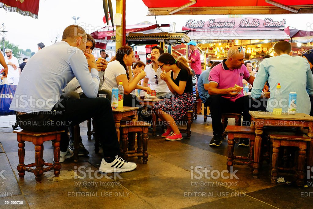 People Eating mackerel sandwich at the Galata Bridge stock photo