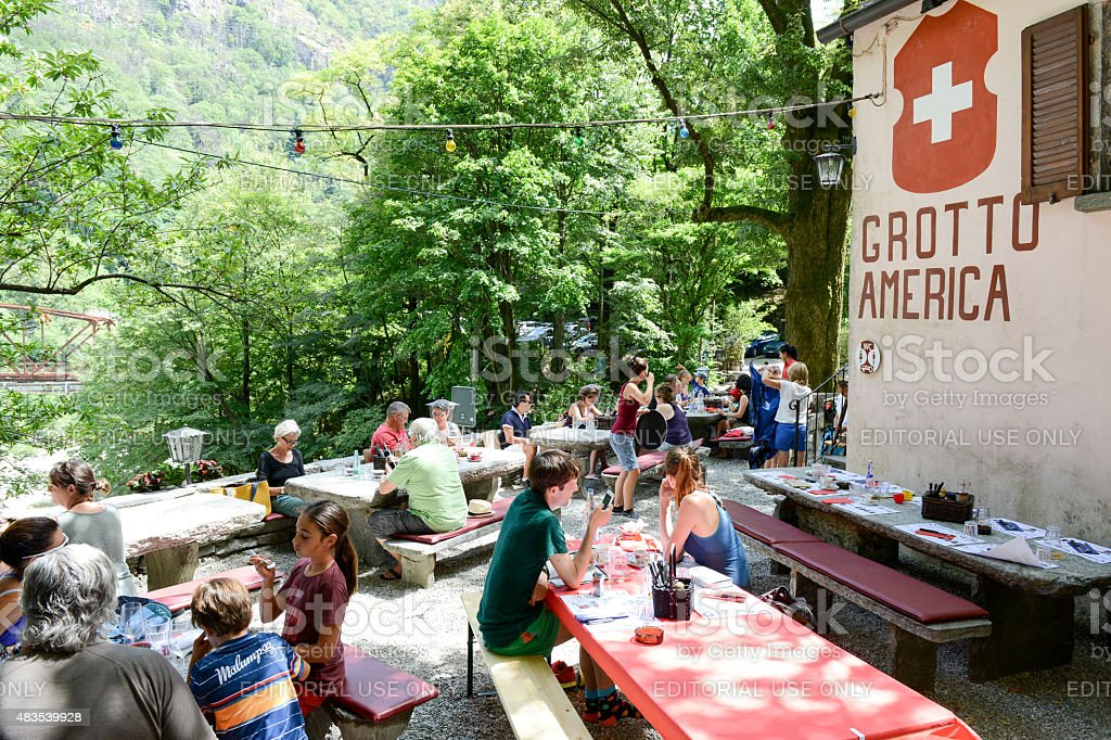 People eating on a Grotto stock photo