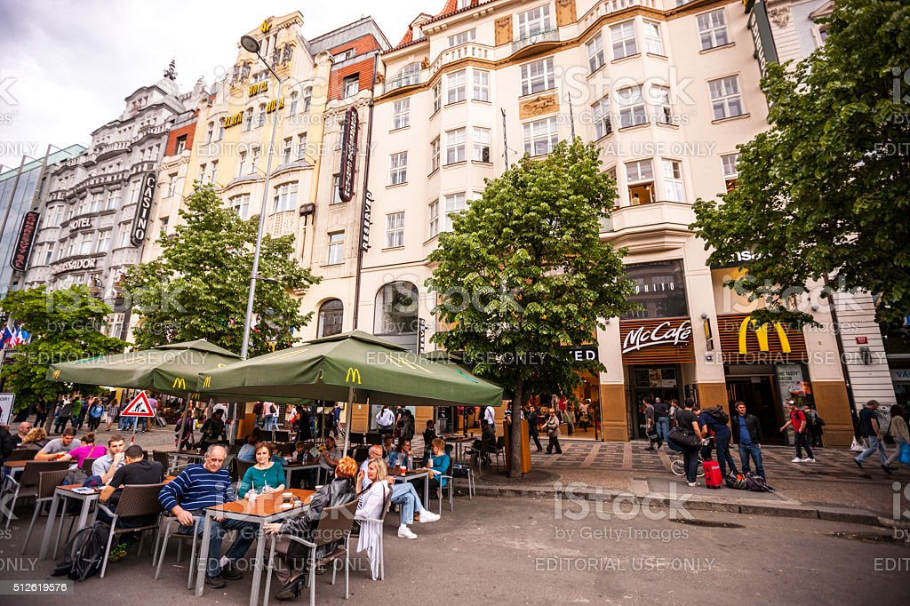 People eating outside in McCafe, Prague stock photo