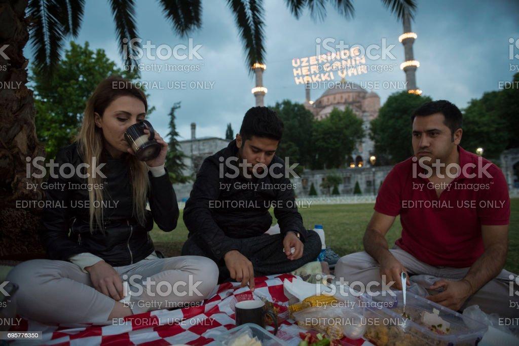 People eating Ramadan iftar meal in Istanbul, Turkey stock photo
