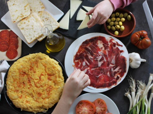 People eating tapas People eating tapas iberian stock pictures, royalty-free photos & images