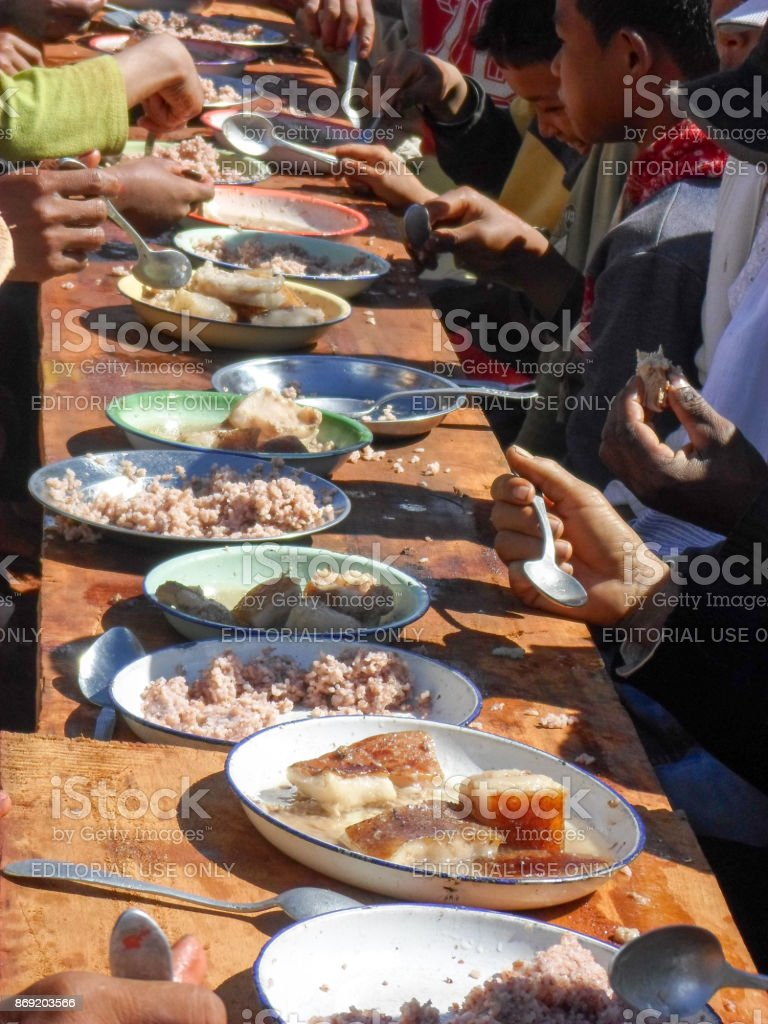 People Eating The Famous Traditional Malagasy Dish Of Red Rice And