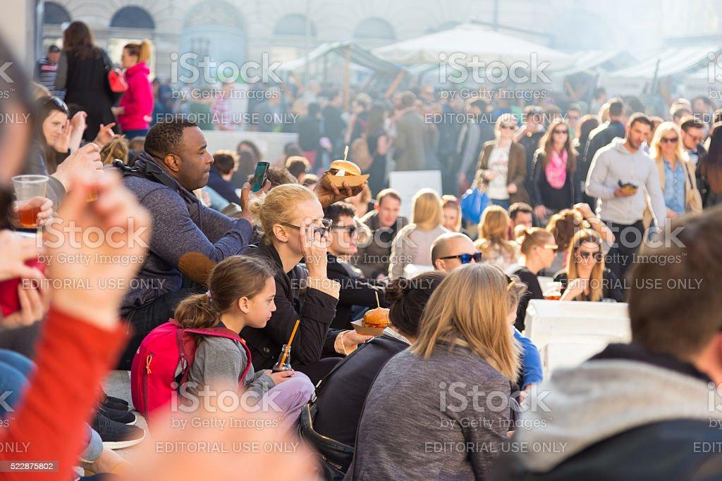 People enjoing outdoor street food festival in Ljubljana, Slovenia. stock photo