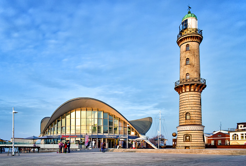 People enjoy a winter day at the lighthouse and at the landmark Teepot in the Baltic Sea resort of Warnemünde