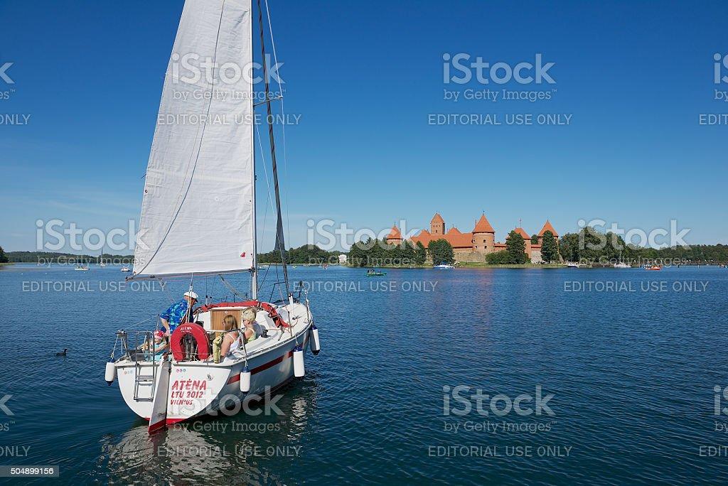 People enjoy boat trip at Galve lake in Trakai, Lithuania. stock photo