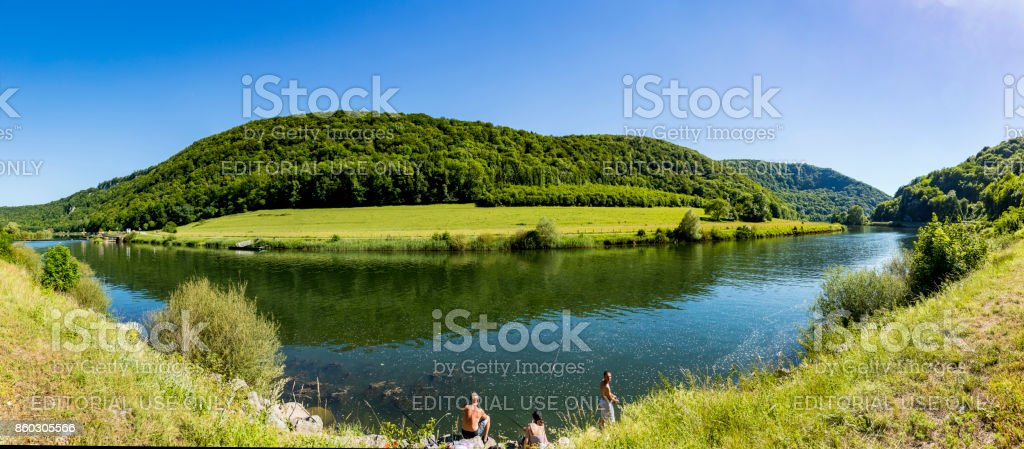 people enjoy cathcing fishes at the river Doubs stock photo