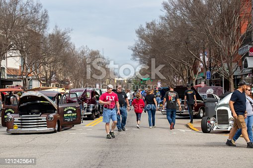 Monroe, Georgia - March 14, 2020: People enjoy classic cars on display at the 15th Annual Memories in Monroe Car Show.