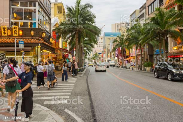 People Enjoy Shopping At Naha Kokusai Dori Shopping Street In Naha Okinawa Stock Photo - Download Image Now