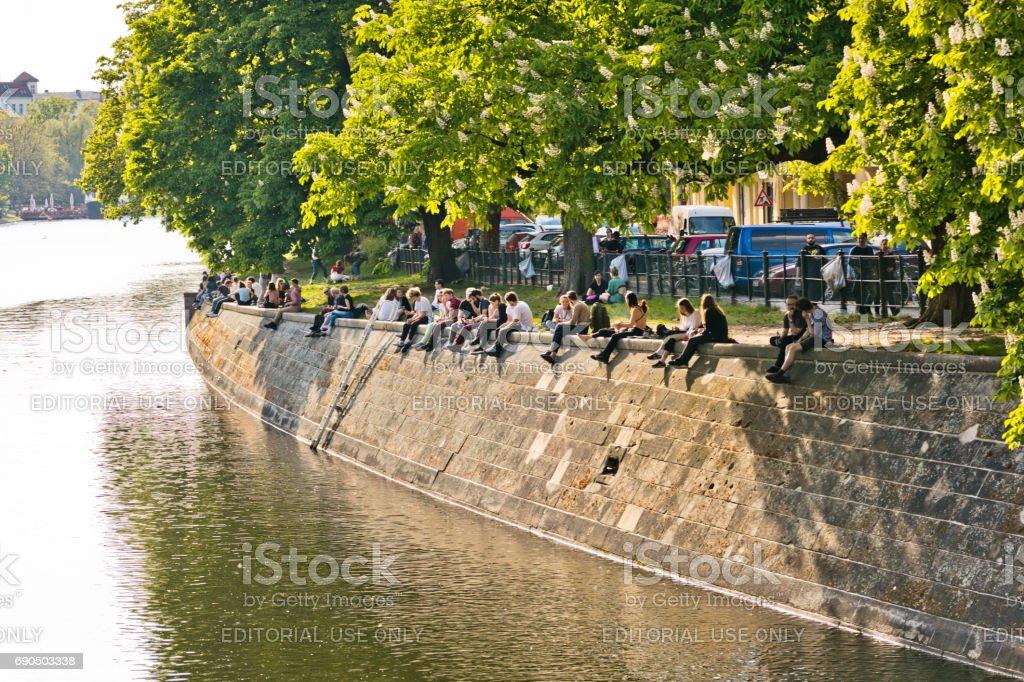 People Enjoy Sun At Landwehrkanal In Berlin Kreuzberg Stock