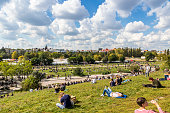 """Berlin: People enjoy sunny Sunday at Mauerpark. Situated in """"death strip"""" of Berlin Wall (Mauer) Mauerpark is now a social, cultural and artistic center of Berlin"""