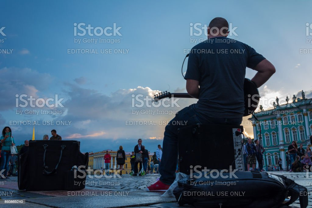 people enjoy the art of street musician in the Palace Square, St. Petersburg, Russia stock photo