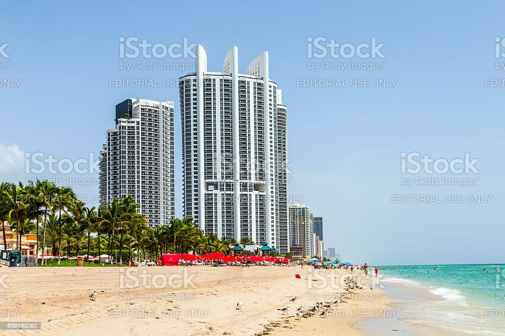 people enjoy the beach at Trump tower stock photo