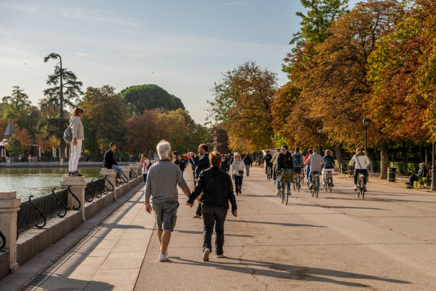 People enjoy the beautiful scenery in El Retiro Park in Madrid stock photo