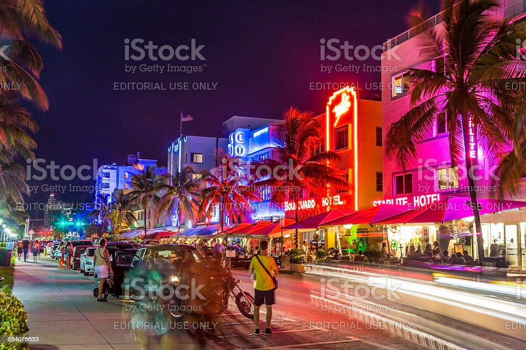 People enjoy the evening at ocean drive stock photo