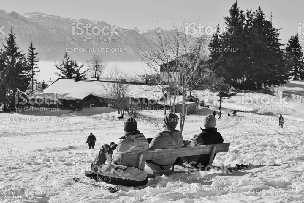 People enjoy the panoramic view of the alps on the mountain Gaisberg, Austria. stock photo