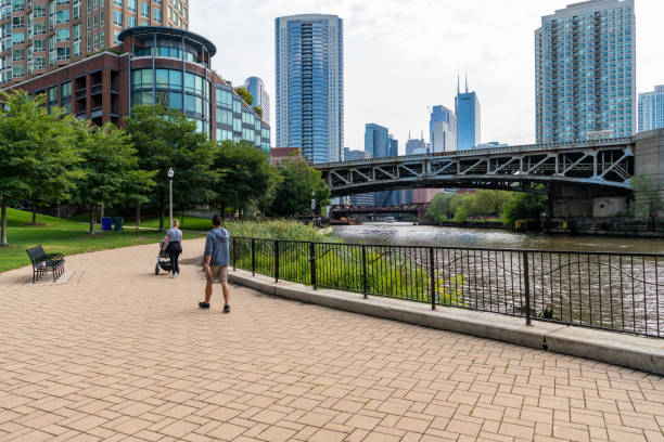 People enjoy the scenery at Montgomery park in Chicago stock photo