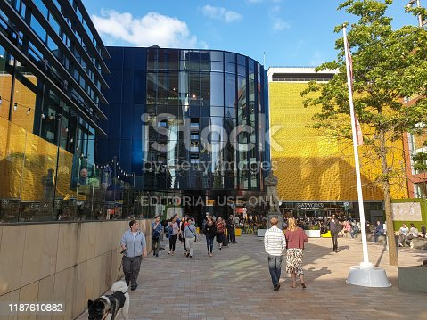 Manchester, United Kingdom - July 13, 2019: People enjoy themlselves at the First Street Development near the HOME centre for art, theatre and film on a sunny summer afternoon