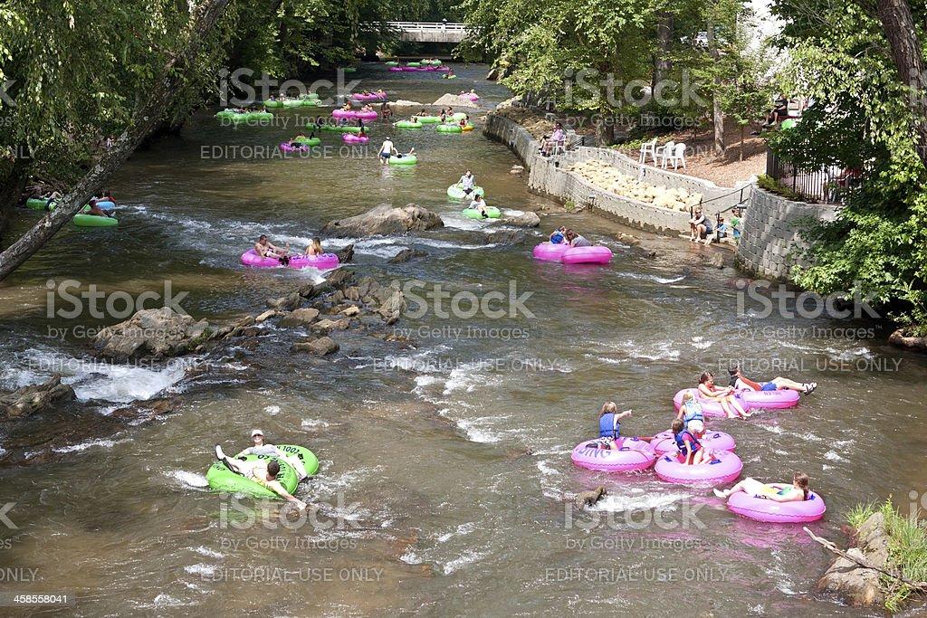People Enjoy Tubing Down North Georgia River stock photo