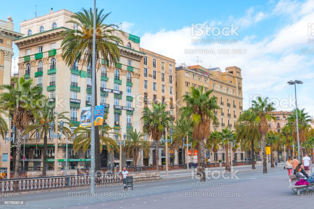 People enjoy warm afternoon.  Street view of Barcelona, Spain. stock photo