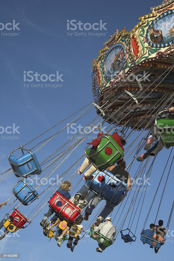 People enjoying a chain ride swing royalty-free stock photo