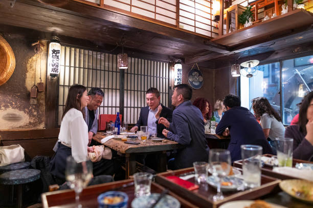 People Enjoying a Dinner and Drinks at a Restaurant in Tokyo stock photo