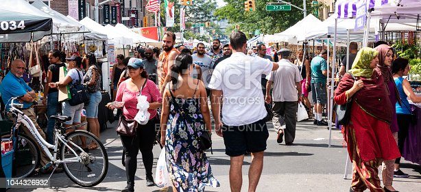 Astoria, NY, USA - 29 July 2018: Many people are out enjoying a local street fair in Astoria Queens, NY.