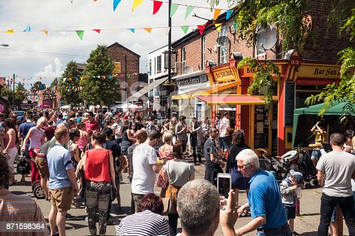 Manchester, UK - People enjoying warm weekend weather in the Manchester suburb of Chorlton during a community street festival.