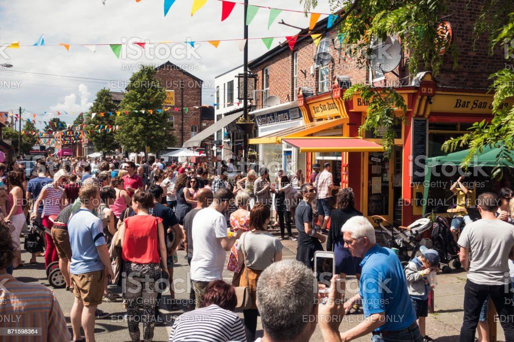 People enjoying a street festival in Chorlton, Manchester stock photo