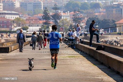 Porto, Portugal - May, 2018: People enjoying a sunny early spring day at the Farolins da Barra do Douro on the beautiful Porto coast near the Douro river mouth