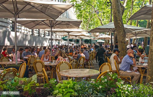 People Enjoying Al Fresco Dinning At Bryant Park Cafe In New York Stock Photo & More Pictures of Bar - Drink Establishment