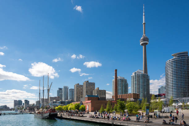 people enjoying beautiful sunny afternoon near lake ontario in toronto - toronto stock pictures, royalty-free photos & images