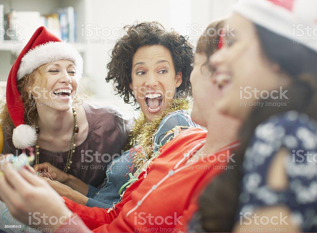 People enjoying Christmas party stock photo