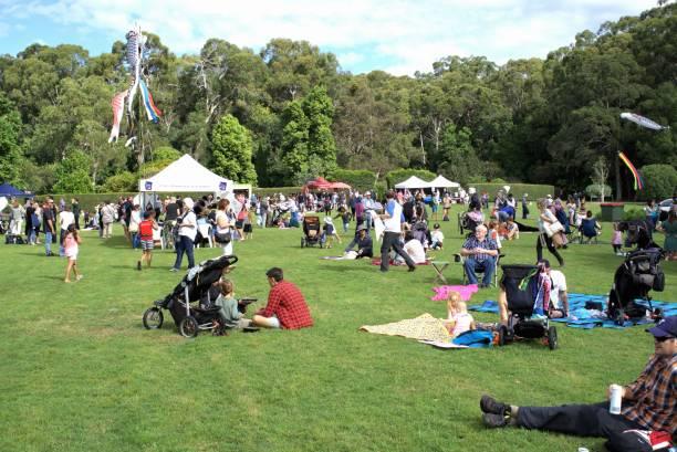 People enjoying day out in park in Australia Coffs Harbour Botanic Garden stock photo