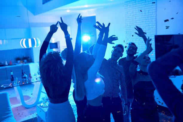 people enjoying house party - party imagens e fotografias de stock