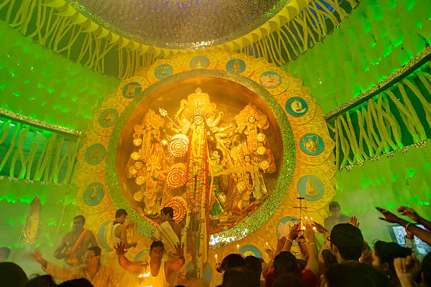 People enjoying inside Durga Puja Pandal, Durga Puja festival stock photo