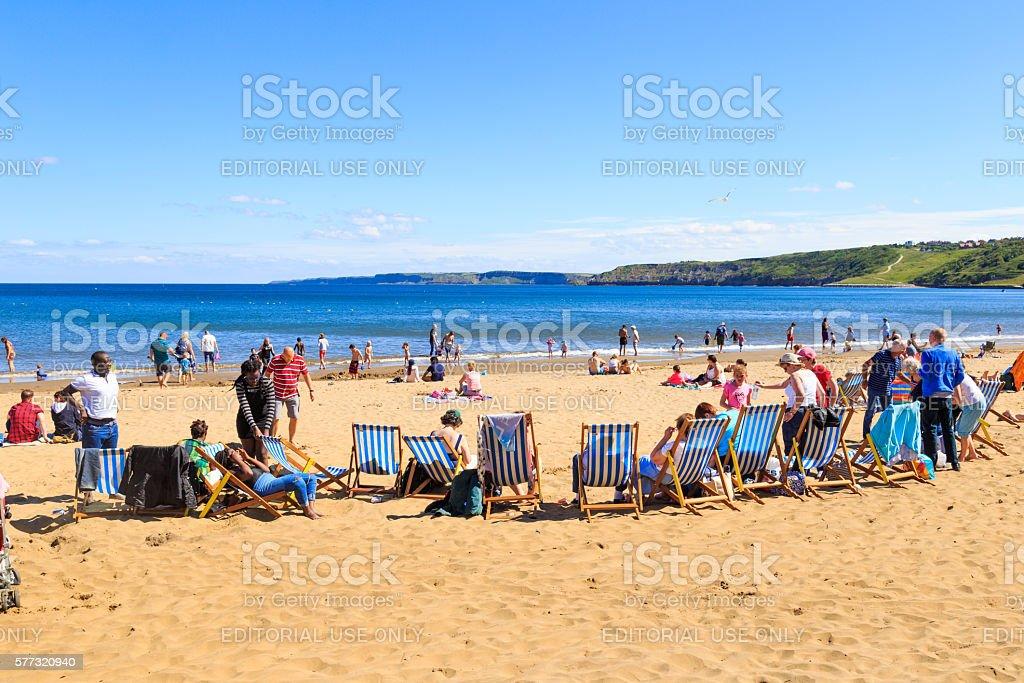 people enjoying Scarborough beach stock photo