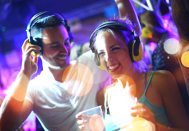 people enjoying silent party. - nightclub stock photos and pictures