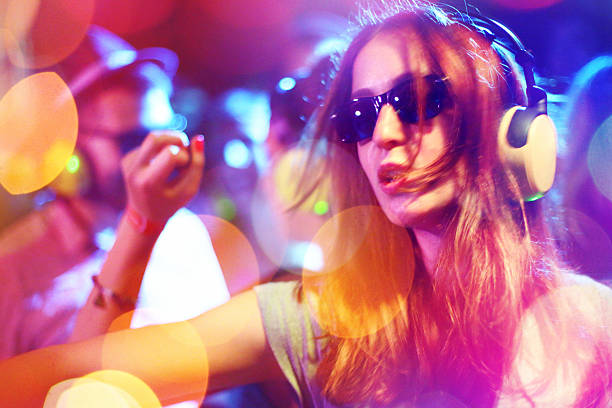 people enjoying silent party. - disco dancing stock photos and pictures